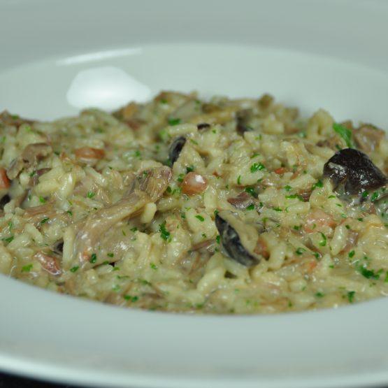 risotto au confit de canard et shiitake plat